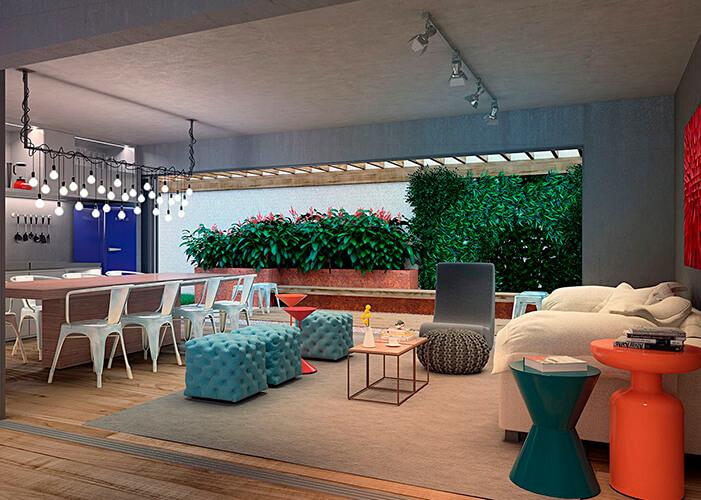 Ambiente integrado sala e cozinha espaçosa e colorida. Detalhe para as plantas ao fundo